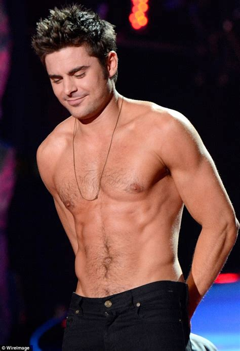 Zac Efron strips shirtless to prove he's back on form at