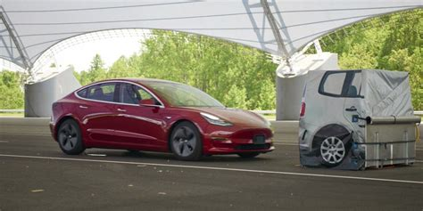 Tesla is pushing back Model 3 delivery windows on new